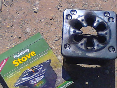 This is a very inexpensive Coghlans stove designed for Sterno or alcohol stoves. But it works well.
