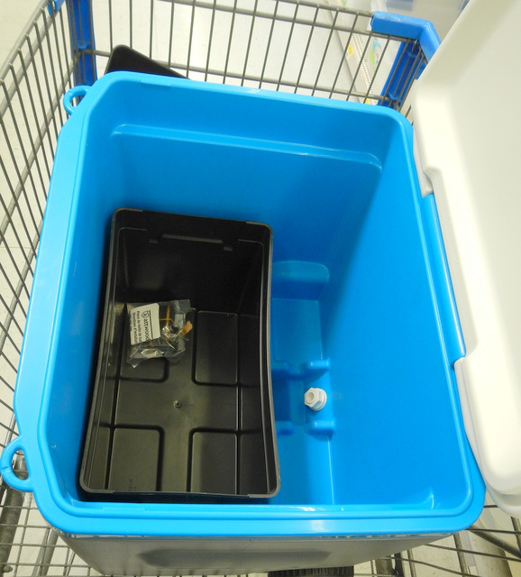 When I went to Walmart to get y ice chest, I put it in the shopping cart and went over to automotive to find a box to put in it to hold the ice. You can see that their battery box fit it perfectly!