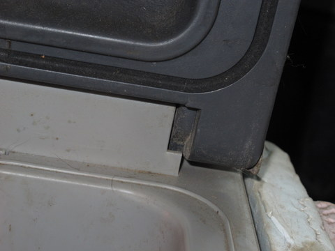 This is the hinge on the Dometic, It is just a plastic  pin that sits in a groove in the body of the fridge.
