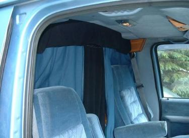 In this picture and the one above, we see examples of a divider curtain. Notice how snugly it fits to the roof.Stop Drafts: Moving air will make you feel much colder than the temperature would indicate, so you want to find and close all air gaps (especially around the doors) with weather stripping and caulk. If you still get a draft, consider duct taping either a Space Blanket or Reflectix around the back door and Velcro in it around the side door. It also keeps the contents safe when you have to take it in for service.