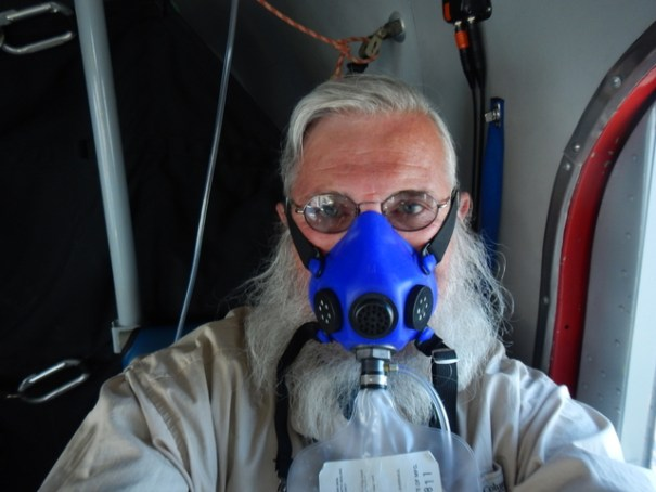I took this selfie of me in the mask on the way back  when I was in the very back of the plane.