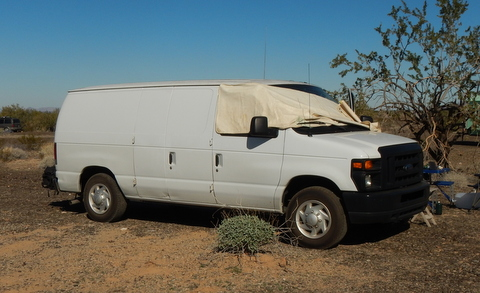 An extended cargo van is easy to find, cheap to buy, has a huge amount of room inside and can get fairly good mpg. A great choice!