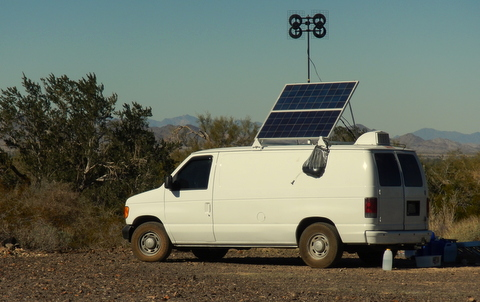 Another great choice with a cargo van but he has innovated with tilting solar panels, TV antenna, vent  and solar shower. Great camp!