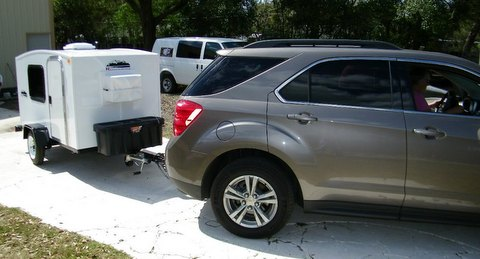 If you tow one with a SUV or mini-van, you'll have lots of room for storage and pretty decent MPG.