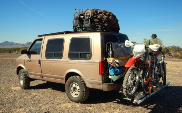This may be the ultimate survival set-up. It's an all-wheel-drive Astro minivan with 280 watts of solar, a 6 inch lift, big mud tires and carrying a dual-spot motorcycle and a bicycles. He can handle just about anything!