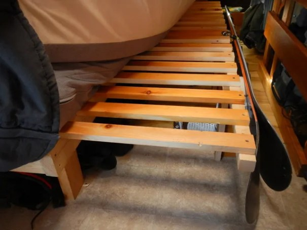 Tis is my friends sliding, pull-out bed. It's a tremendous space saver in a van and easier than you think to build.