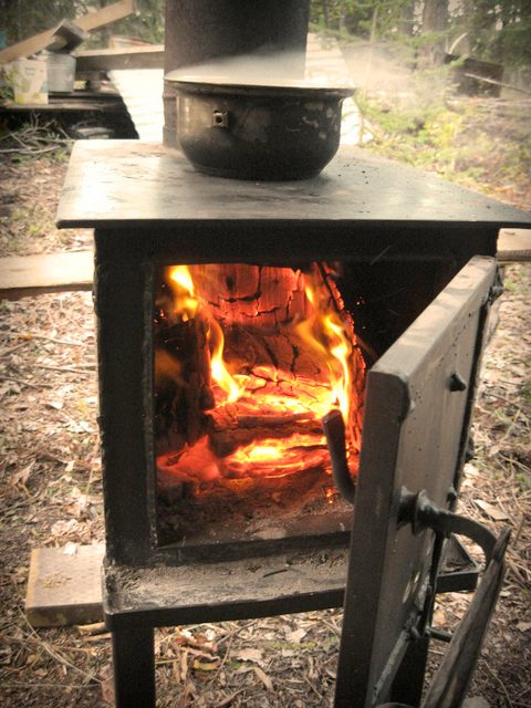 Insulation is no good without a source of heat. Cud welded this woodstove himself and found it worked great in the van.
