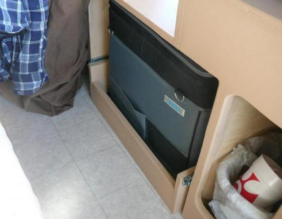 In this shot you can see the linoleum he put down. Notice also his Dometic 12 volt fridge ticked into the cabinet.