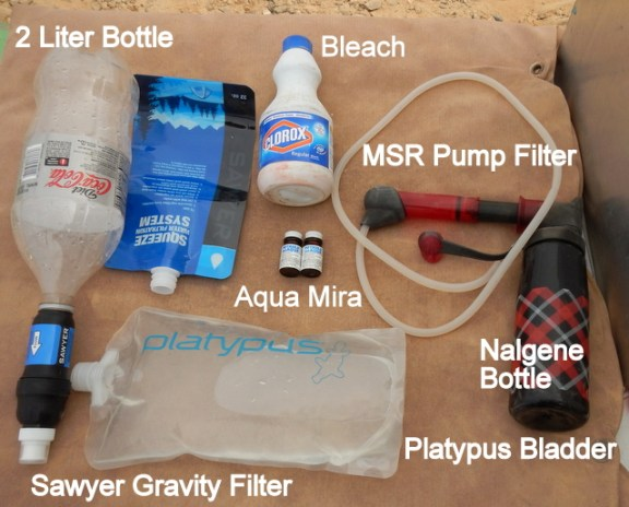 This is my water treatment system: 1) A gravity filter 2) Pump filter 3) Bleach 4) Aqua Mira Tablets.