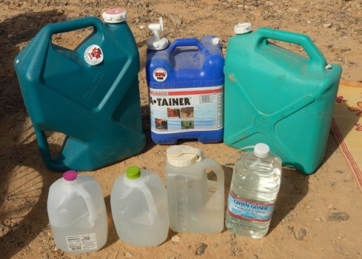 I carry these water jugs, but to save weight I don't keep them all full. If I suspect a weather event is coming, I will fill them all.