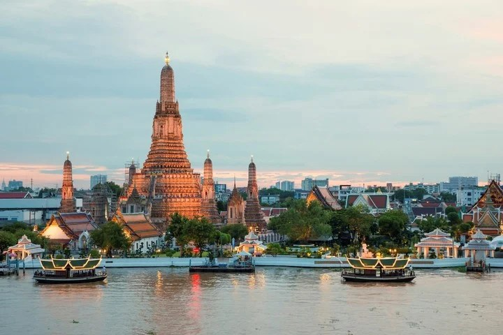 Ancient temples and modern life in Bangkok, the capital of Thailand