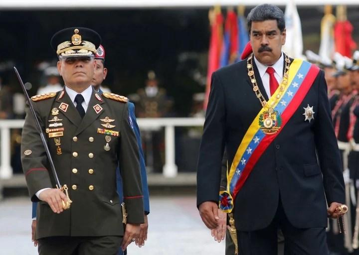 Nicolas Maduro and Vladimir Padrino Lopez, in March of last year.  AP Photo
