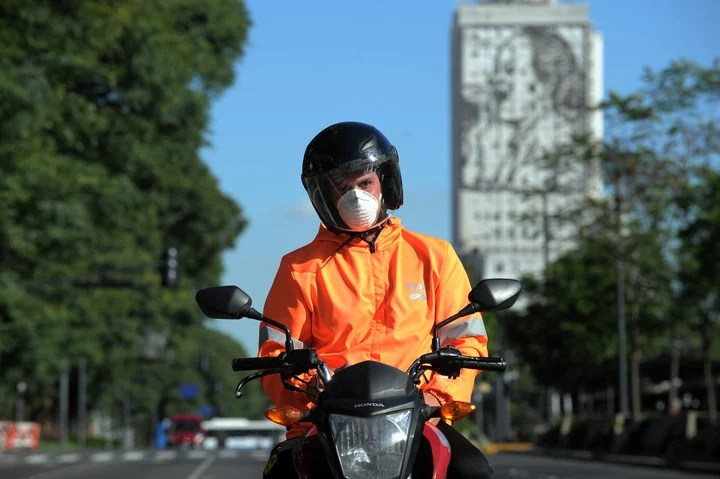 Motorcyclists.  Obligatory homologated helmet and appropriate clothing.  Photo Juano Tesone