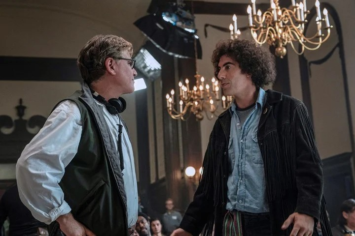 """Writer / director Aaron Sorkin talks to Sacha Baron Cohen on the set of """"The Chicago 7 trial"""".  Netflix photo"""
