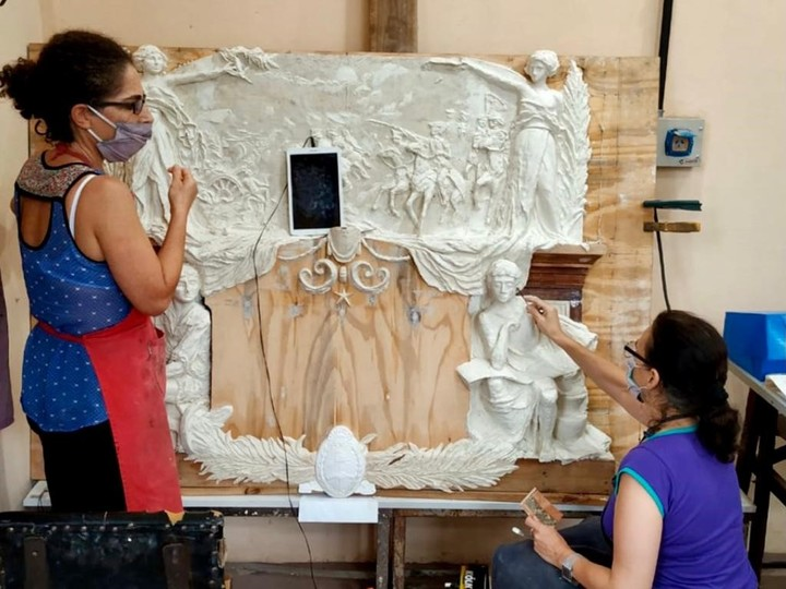 The work of restorers, making use of technology, to recover and preserve valuable pieces of heritage.