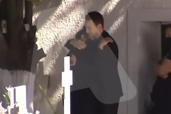 Anagnostopoulos's embrace with his victim's mother, Caroline Crouch.  Photo Capture TV