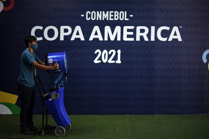 A member of Conmebol staff performs cleaning and disinfection tasks before the 2021 Copa América soccer match between Uruguay and Chile, at the Arena Pantanal in Cuiaba, Mato Grosso state, Brazil.  Photo by DOUGLAS MAGNO / AFP-