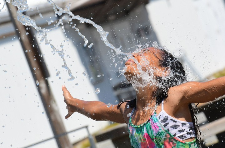 Girl cools off in British Columbia, Canada, amid the heat wave.  Photo Reuters.