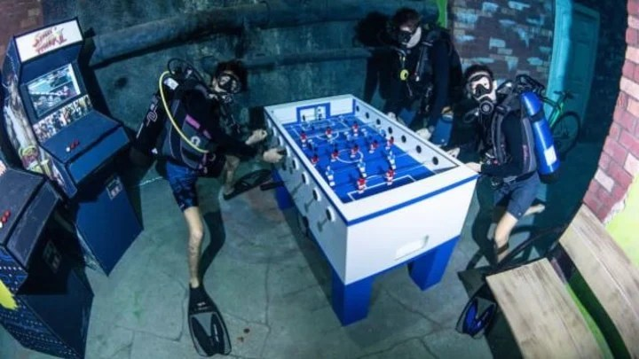 There is so much to do at the Deep Dive Dubai pool that you can even play foosball.