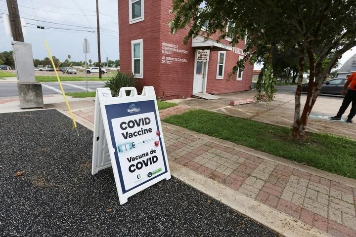 A sign in front of a vaccination center in Brownsville, Texas.  Photo: AP