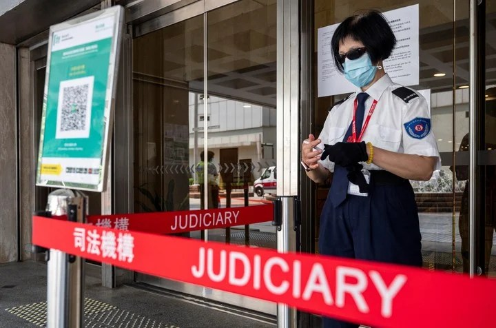 A security officer stands at the door of the Hong Kong court where the trial took place.  Photo: EFE