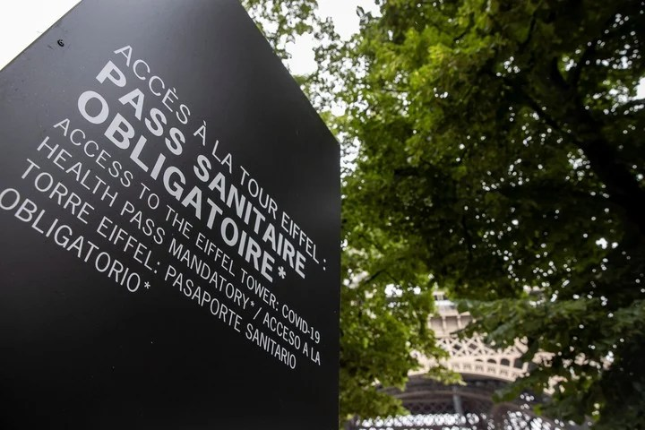 A sign next to the Eiffel Tower in Paris warns that a health passport is mandatory.  Photo: EFE