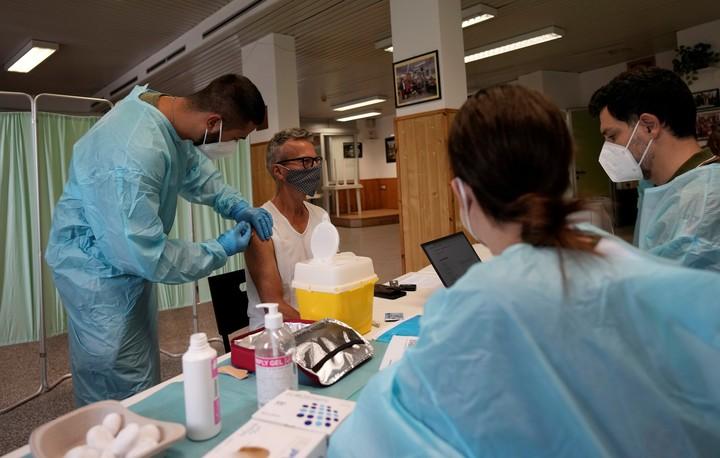 In Milan, applying the coronavirus vaccine.  AP Photo