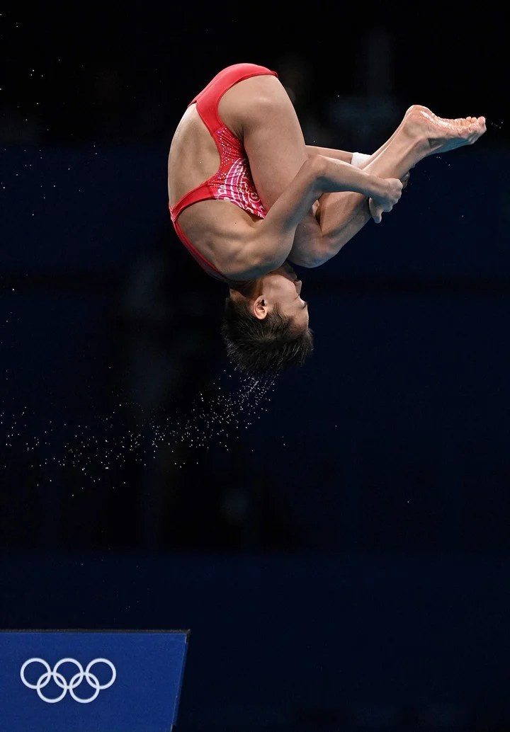 Perfect jumps from China's Quan Hongchan in Tokyo.  Photo Oli SCARFF / AFP
