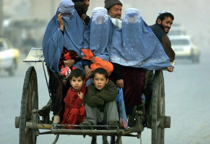 The men had to grow beards and the women had to wear a burqa that covered everything.  Photo: AP