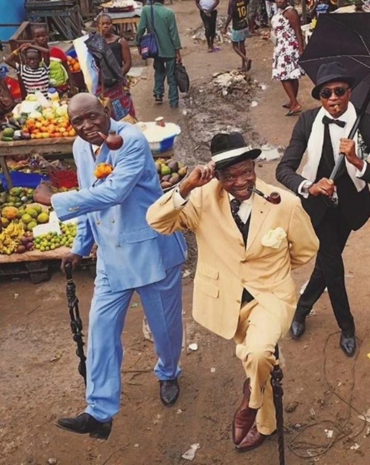 The Dandis of the Congo wear their clothes on the unpaved streets of Brazzaville.