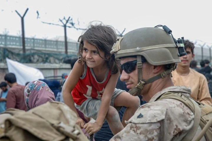 The images released by the US Army, in which the soldiers were seen accompanied by children.  AFP photo