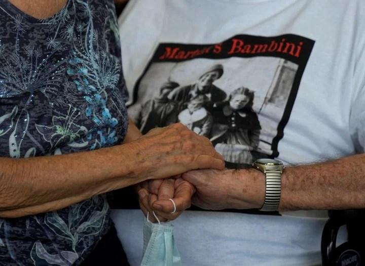 Handshake of Martin Adler and Giuliana Naldi.  Photo: AP