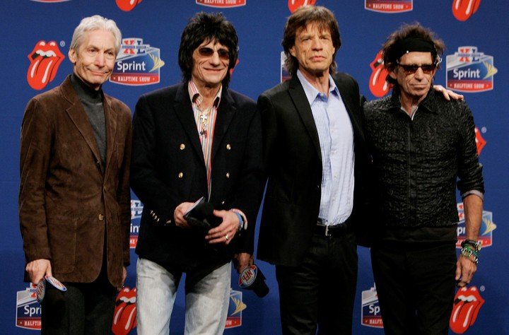 Charlie Watts, Ron Wood, Mick Jagger, and Keith Richards.  The Rolling Stones.  AP Photo / Michael Conroy, File)