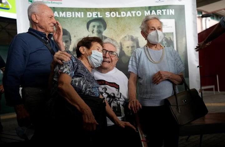Martin Adler poses with Giulio (left), Mafalda (right) and Giuliana Nald.  Photo: AP