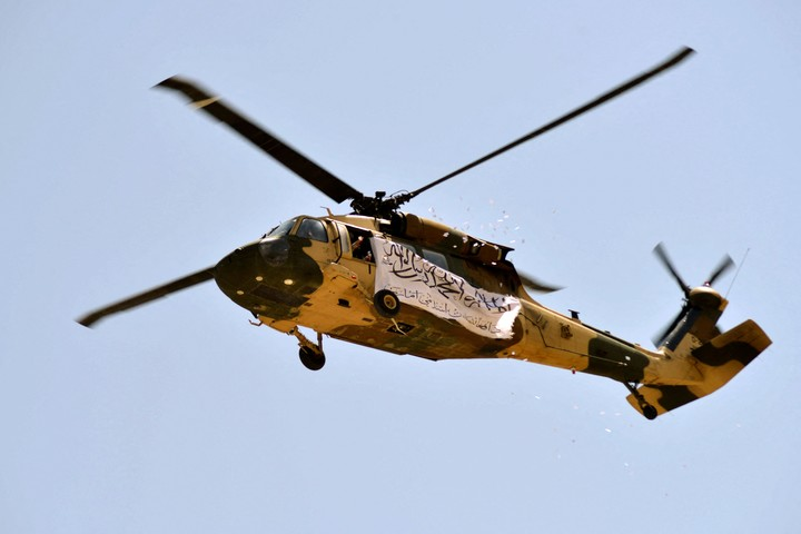 A helicopter with a Taliban flag was also seen in the parade.  Photo: AFP
