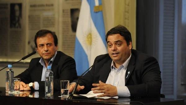 Jorge Triaca junto a Mario Quintana en conferencia de prensa en Casa Rosada.  (Pedro Lázaro Fernández)