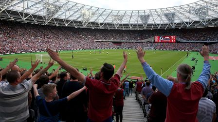 West Ham fans in the stands during the Premier League match at London Stadium, London.  ASS PRESS