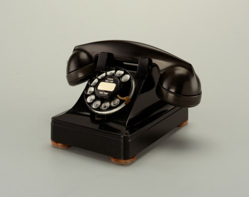 small resolution of black rotary telephone transmitter receiver handset in cradle on raised body with square base