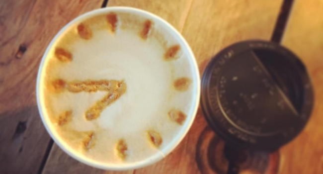 Coffee with clock drawn onto froth from 92 degrees coffee Liverpool