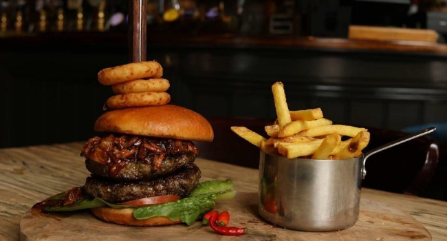 burger-topped-with-onion-rings-with-side-of-fries-from-the-navigation-inn-nottingham