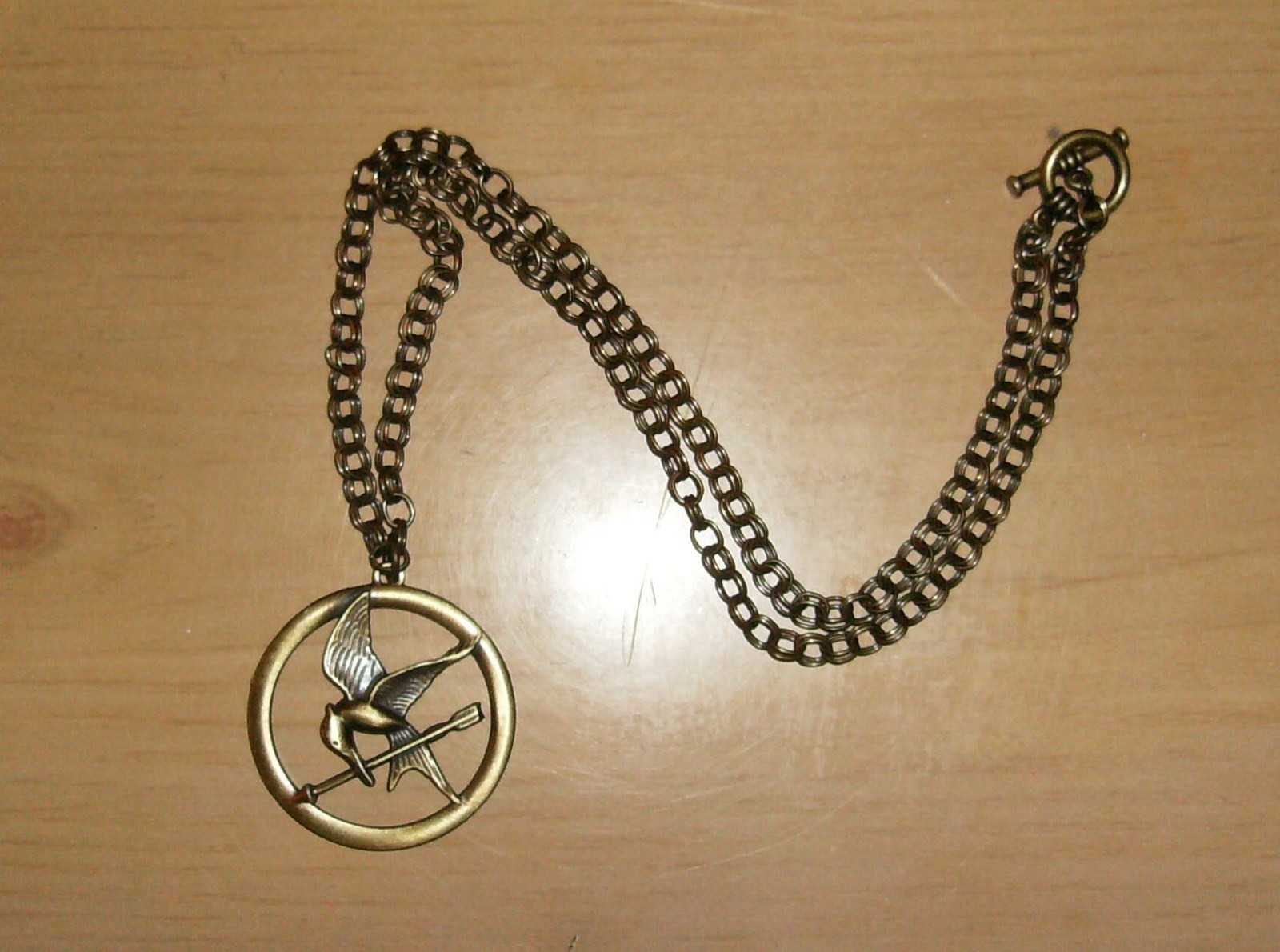 The Hunger Games Mockingjay Pendant Necklace How To Make A Metal Necklace Jewelry Making