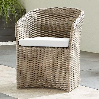 where to buy wicker chairs chair back covers australia resin patio furniture crate and barrel cayman outdoor dining with white sand sunbrella cushion