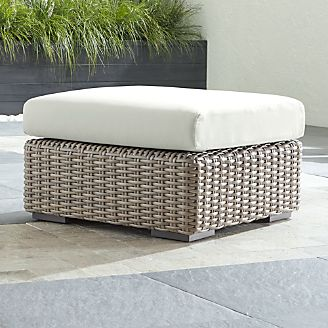 resin wicker chair with ottoman jaxx bean bag patio furniture crate and barrel cayman outdoor white sand sunbrella cushion