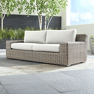woven outdoor chair hayneedle adirondack chairs rattan furniture crate and barrel cayman sofa with white sand sunbrella cushions