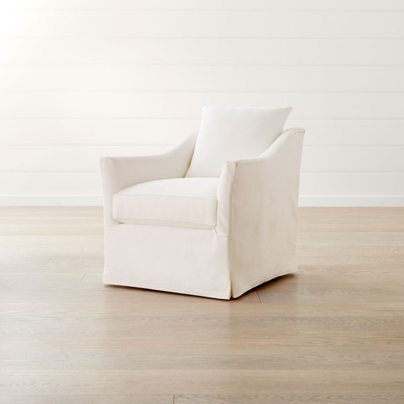 swivel chair definition upholstered dining chairs nz keely slipcovered reviews crate and barrel