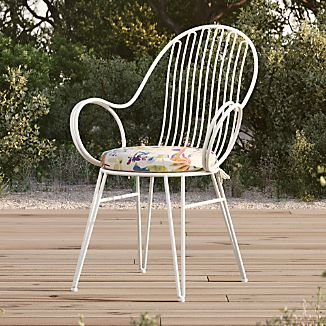 woven outdoor chair comfy living room chairs crate and barrel scroll white metal dining with tropic cushion