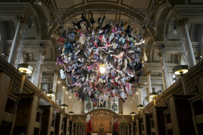 A Chandelier Made Of Clothes Left By Refugees On The Ss Greek Island S Hangs In St James Church London Dec