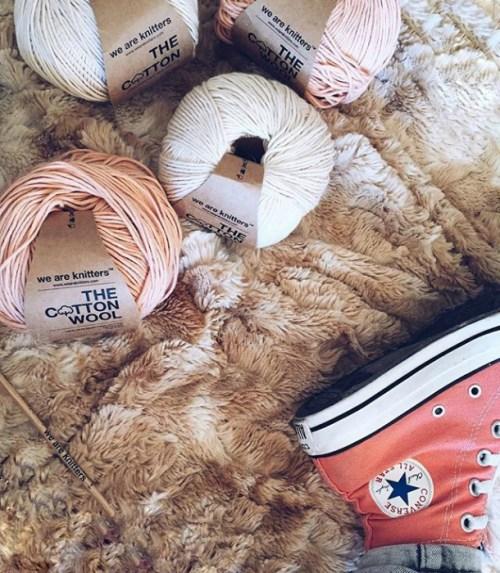 foot-rests-near-balls-of-yarn