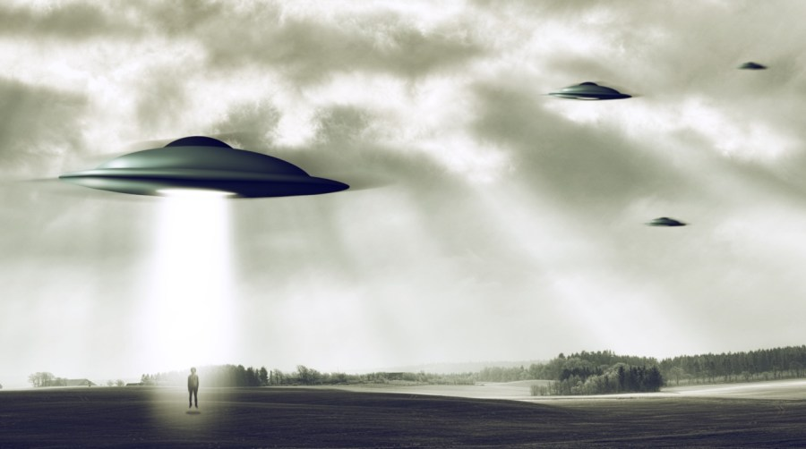 Group of UFOs flying with one abducting a human