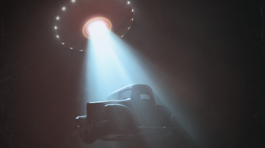 UFO lifts truck with a beam of light